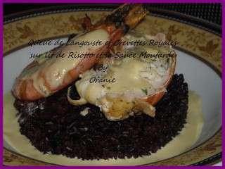 Queue de langouste et crevettes royales sur lit de risotto et sa sauce  moutarde